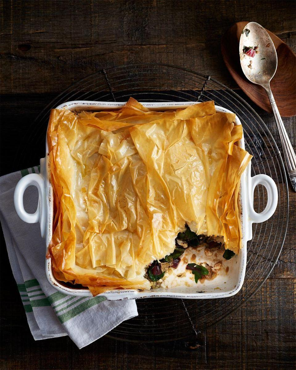 """<p>The flaky top to this bake, made from phyllo, offers a light layer to balance the heartier ingredients beneath it. </p><p><strong><a href=""""https://www.countryliving.com/food-drinks/recipes/a36149/swiss-chard-lamb-bake/"""" rel=""""nofollow noopener"""" target=""""_blank"""" data-ylk=""""slk:Get the recipe"""" class=""""link rapid-noclick-resp"""">Get the recipe</a>.</strong></p><p><strong><a class=""""link rapid-noclick-resp"""" href=""""https://www.amazon.com/Bakeware-Krokori-Rectangular-Aquamarine-Rectangula/dp/B074Z5X8MT/?tag=syn-yahoo-20&ascsubtag=%5Bartid%7C10050.g.3726%5Bsrc%7Cyahoo-us"""" rel=""""nofollow noopener"""" target=""""_blank"""" data-ylk=""""slk:SHOP CASSEROLE DISHES"""">SHOP CASSEROLE DISHES</a><br></strong></p>"""