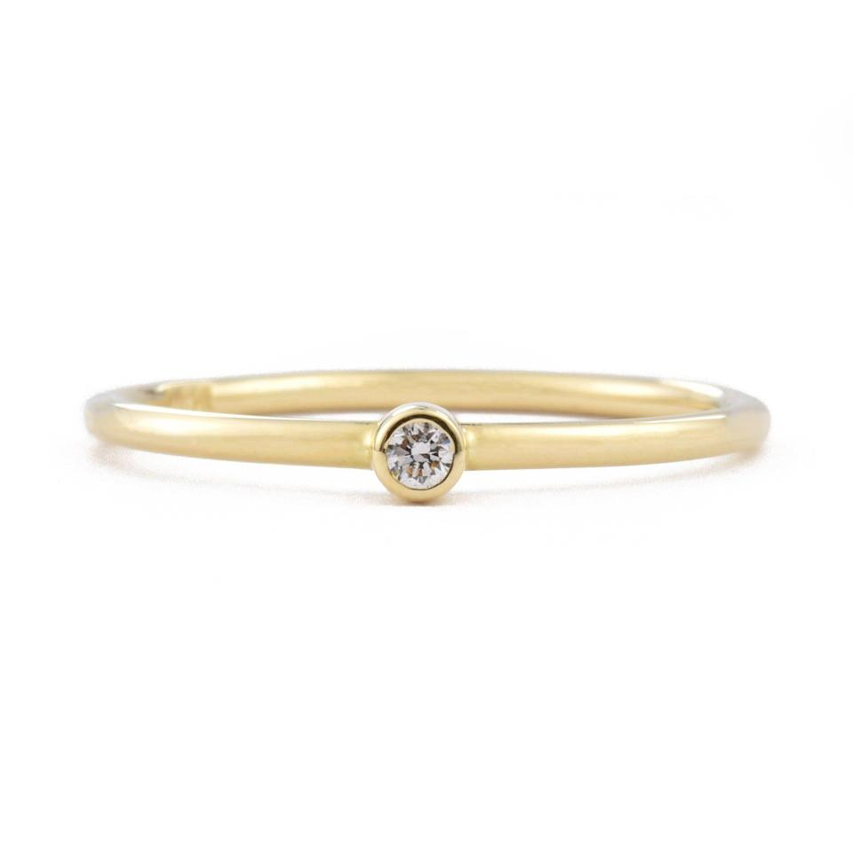 """<p><strong>Valerie Madison</strong></p><p>valeriemadison.com</p><p><strong>$225.00</strong></p><p><a href=""""https://www.valeriemadison.com/collections/under-500/products/14k-gold-tiny-diamond-stackable-ring-vm130"""" rel=""""nofollow noopener"""" target=""""_blank"""" data-ylk=""""slk:Shop Now"""" class=""""link rapid-noclick-resp"""">Shop Now</a></p><p>Diamond is the MVP of the gemstone world. It enhances the self-esteem and confidence of the wearer, helping you radiate self-worth and attract success. Try wearing one on the left-hand side for luck. </p>"""