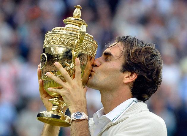 Roger Federer of Switzerland kisses the winners trophy after defeating Andy Murray of Britain in their men's singles final tennis match at the Wimbledon Tennis Championships in London July 8, 2012.      REUTERS/Toby Melville