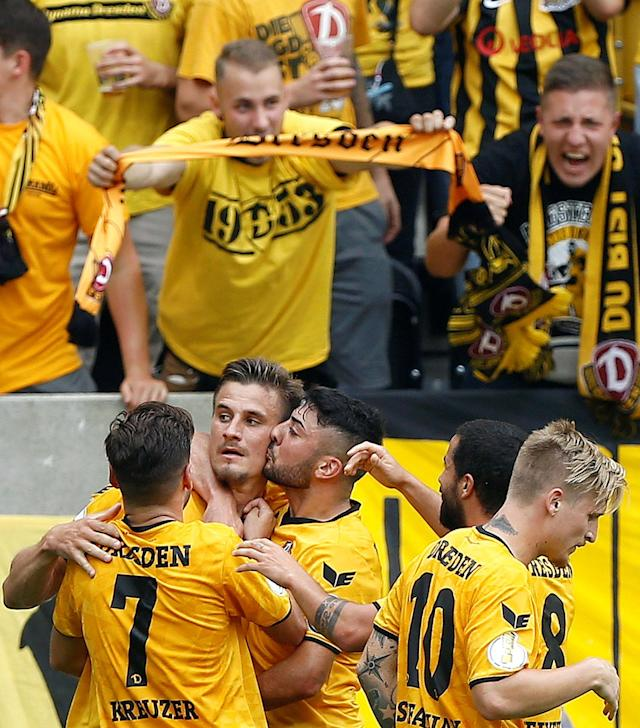 Football Soccer - Dynamo Dresden v RB Leipzig - German Cup (DFB Pokal) - DDV-Stadion, Dresden, Germany - 20/08/16. Dynamo Dresden's Stefan Kuschke (2ndL) and his team mates celebrate after he scored. REUTERS/Axel Schmidt. DFB RULES PROHIBIT USE IN MMS SERVICES VIA HANDHELD DEVICES UNTIL TWO HOURS AFTER A MATCH AND ANY USAGE ON INTERNET OR ONLINE MEDIA SIMULATING VIDEO FOOTAGE DURING THE MATCH.