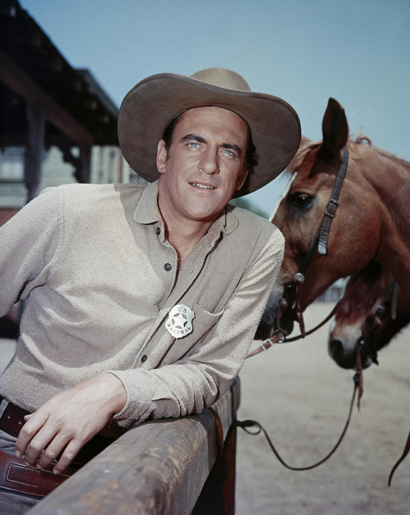 "FILE - In this undated publicity image released by CBS, Actor James Arness is shown as Marshal Matt Dillon in ""Gunsmoke."" CBS spokesman Chris Ender says former ""Gunsmoke"" star James Arness died Friday, June 3, 2011 of natural causes. He was 88. (AP Photo/CBS) NO SALES. NORTH AMERICA USE ONLY."