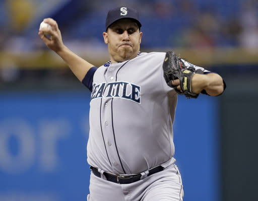 Seattle Mariners starting pitcher Aaron Harang delivers to Tampa Bay Rays' Ben Zobrist during the first inning of a baseball game Wednesday, Aug. 14, 2013, in St. Petersburg, Fla. (AP Photo/Chris O'Meara)