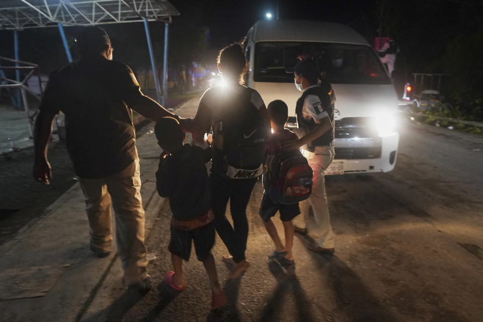 Mexican immigration agents detain a Central American migrant who is part of a caravan heading north in Huixtla, Chiapas state, Mexico, Sunday, Sept. 5, 2021. (AP Photo/Marco Ugarte)