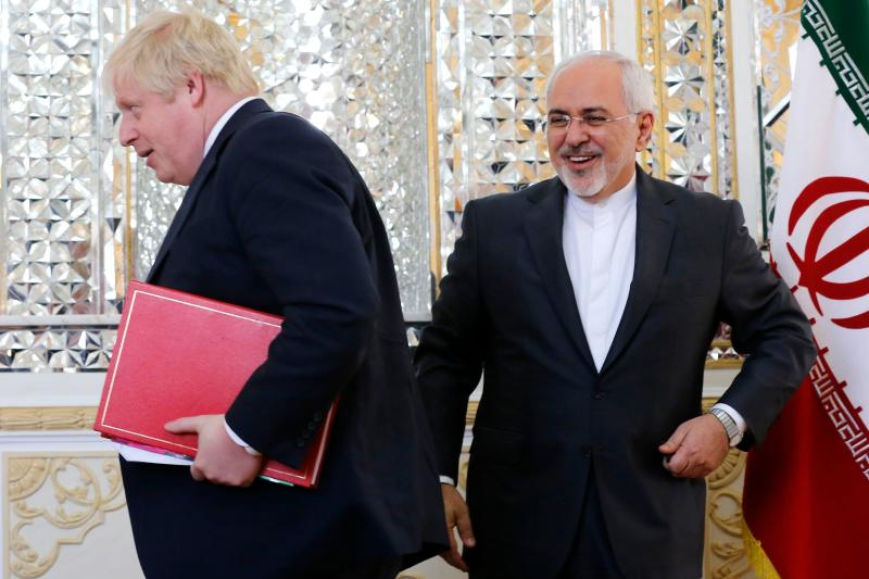 <strong>Boris Johnson, seen here with the country's foreign minister, has ended his Iran trip without an announcement on the case of a jailed British mother</strong> (ATTA KENARE via Getty Images)