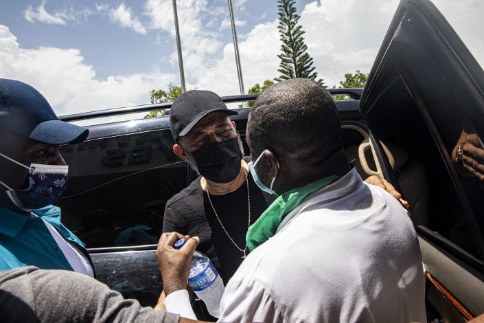 Michel Martelly, the former president of Haiti, leaves a hospital in the earthquake-stricken town of Les Cayes, Aug. 20, 2021. (Adriana Zehbrauskas/The New York Times)