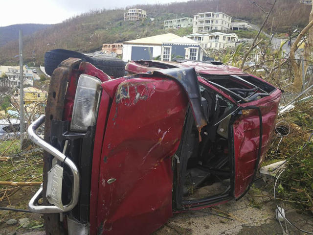 <p>A damaged vehicle is flipped on its side in the aftermath of Hurricane Irma in Tortola, in the British Virgin Islands, on Sept. 7, 2017. (Photo: Jalon Manson Shortte via AP) </p>