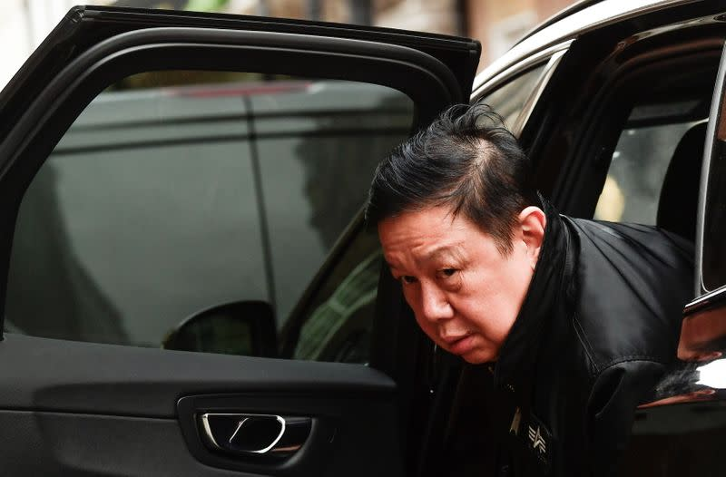 Myanmar's ambassador Kyaw Zwar Minn leaves in a car outside the Myanmar Embassy in London