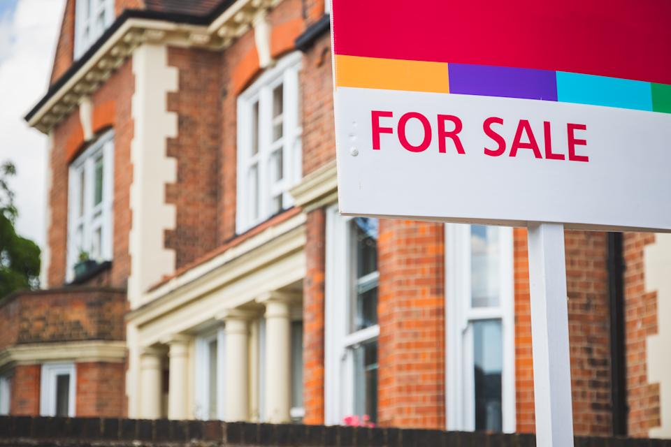 For Sale estate agent sign displayed outside a terraced house in Crouch End, London