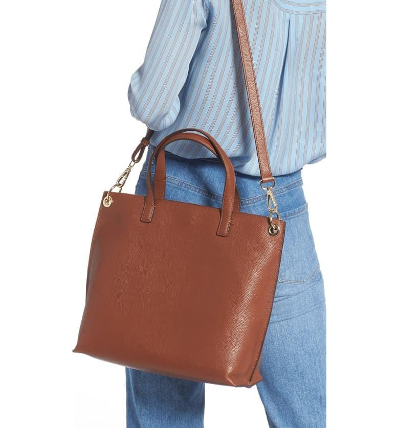 """<p>This <a href=""""https://www.popsugar.com/buy/Nordstrom-Nicole-Leather-Tote-483610?p_name=Nordstrom%20Nicole%20Leather%20Tote&retailer=shop.nordstrom.com&pid=483610&price=179&evar1=fab%3Aus&evar9=45623846&evar98=https%3A%2F%2Fwww.popsugar.com%2Ffashion%2Fphoto-gallery%2F45623846%2Fimage%2F46532964%2FNordstrom-Nicole-Leather-Tote&list1=shopping%2Caccessories%2Cbags%2Cworkwear&prop13=mobile&pdata=1"""" rel=""""nofollow"""" data-shoppable-link=""""1"""" target=""""_blank"""" class=""""ga-track"""" data-ga-category=""""Related"""" data-ga-label=""""https://shop.nordstrom.com/s/nordstrom-nicole-leather-tote/5217160?origin=category-personalizedsort&amp;breadcrumb=Home%2FWomen%2FHandbags%2FTote%20Bags&amp;color=brown%20aztec"""" data-ga-action=""""In-Line Links"""">Nordstrom Nicole Leather Tote</a> ($179) features a convenient front pocket.</p>"""