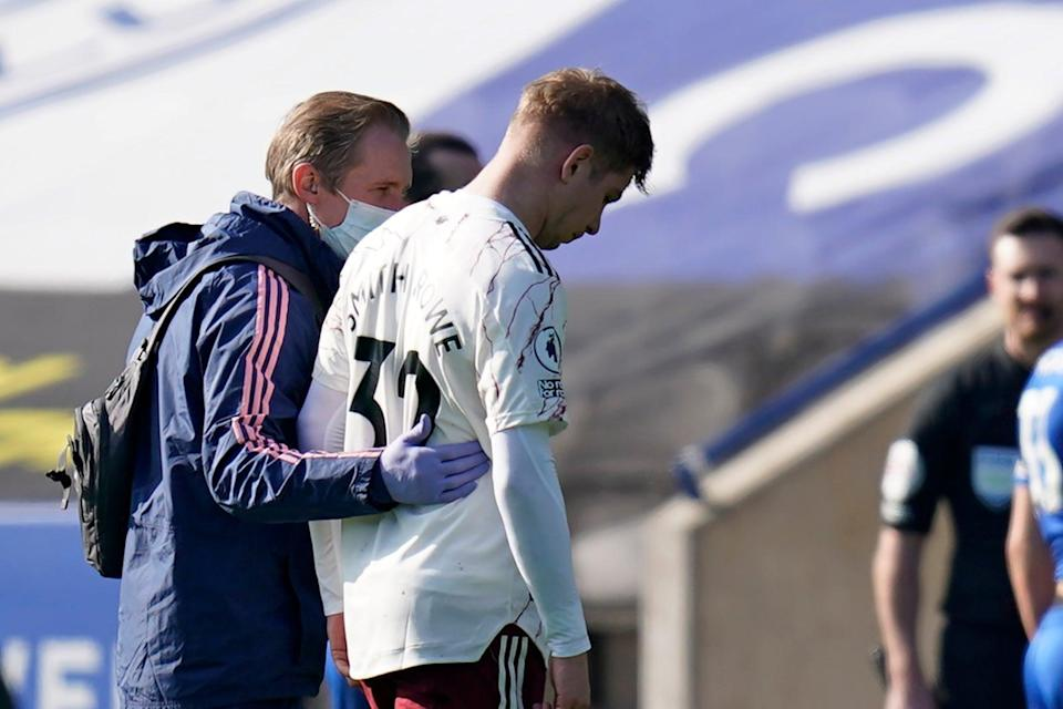 <p>Injury blow: Arsenal's Emile Smith Rowe limped off before half-time against Leicester</p> (POOL/AFP via Getty Images)