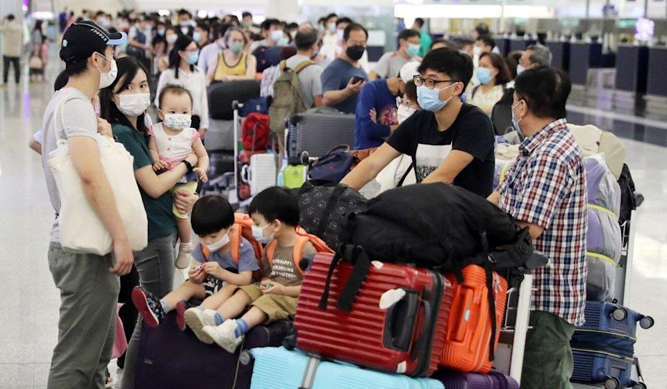 Thousands of Hongkongers appear to be leaving the city. Photo: Edmond So