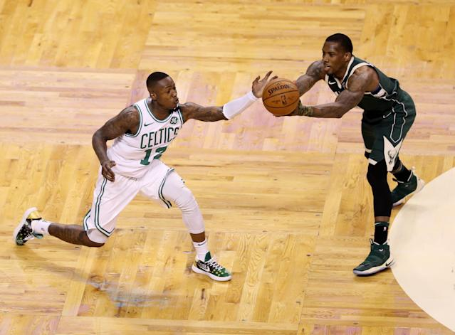 "Celtics guard <a class=""link rapid-noclick-resp"" href=""/nba/players/5476/"" data-ylk=""slk:Terry Rozier"">Terry Rozier</a> showed up to TD Garden on Monday night rocking a Patriots Drew Bledsoe jersey, getting the last laugh in his feud with Bucks guard <a class=""link rapid-noclick-resp"" href=""/nba/players/4749/"" data-ylk=""slk:Eric Bledsoe"">Eric Bledsoe</a>. (Getty Images)"