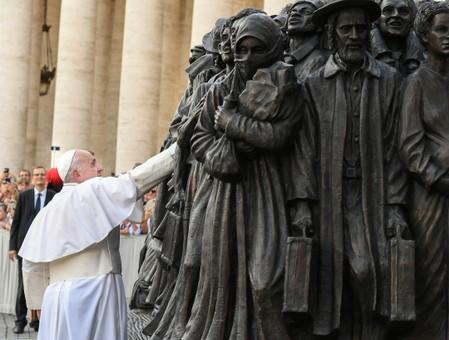 Pope Francis attends the unveiling of a sculpture depicting a group of migrants of various cultures and from different historic times, following a mass for World Day of Migrants and Refugees, at St. Peter's Square at the Vatican