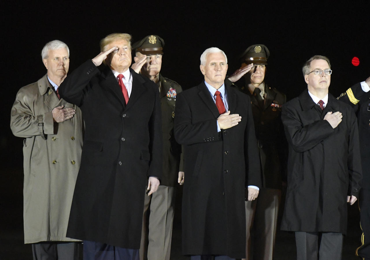 From left, General Counsel of the Army James McPherson, President Donald Trump, Army Chief of Staff Gen. James C. McConville, Vice President Mike Pence, Sgt. Maj. Michael Grinston and Deputy Secretary of Defense David Norquist stand during the casualty return of Sgt. 1st Class Javier J. Gutierrez and Sgt. 1st Class Antonio Rey Rodriguez, Monday, Feb. 10, 2020, at Dover Air Force Base, Del. According to the Department of Defense, Gutierrez, 28, of San Antonio, and Rodriguez, 28, of Las Cruces, N.M., died in Nangarhar province, Afghanistan, of wounds sustained during combat operations. (AP Photo/Steve Ruark)