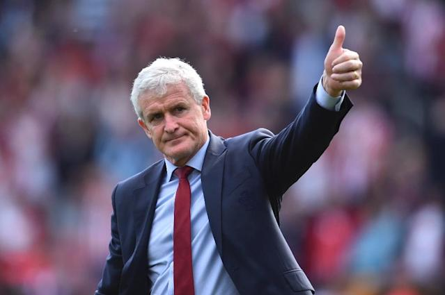 Mark Hughes has been rewarded for keeping Saints in the Premier League (AFP Photo/Glyn KIRK )