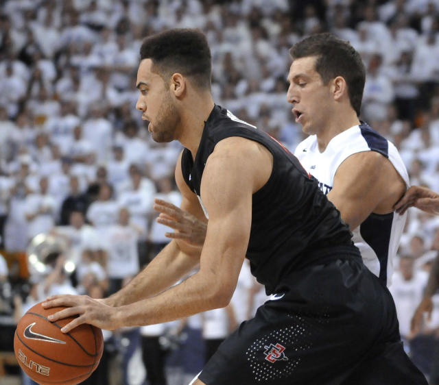 San Diego State forward JJ O'Brien grabs a rebound as Utah State guard/forward Spencer Butterfield defends during the first half of an NCAA college basketball game Saturday, Jan. 25, 2014, in Logan, Utah. (AP Photo/Eli Lucero)