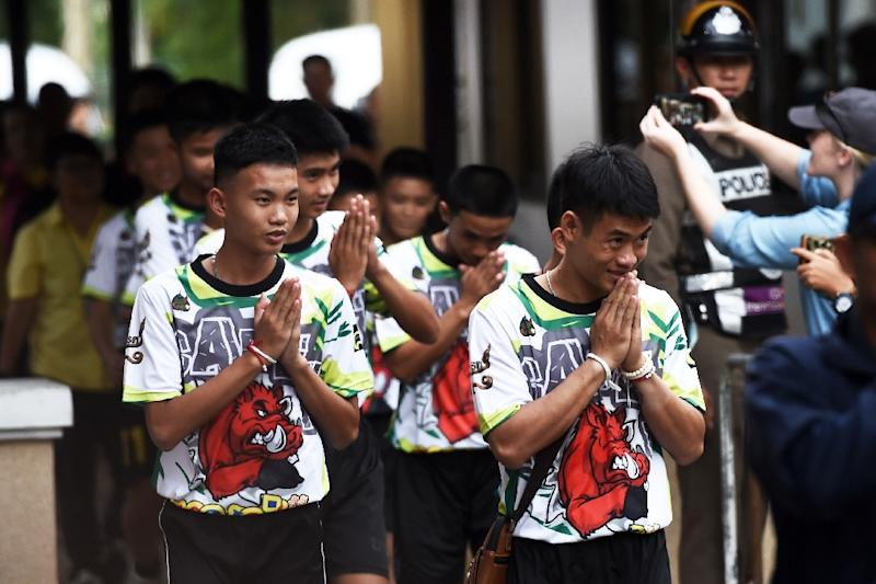 Authorities organized a tightly controlled press conference with the boys the same evening in which they recounted drinking water that dripped from rocks and trying to dig their way out during the first nine days before they were located (AFP Photo/Lillian SUWANRUMPHA)