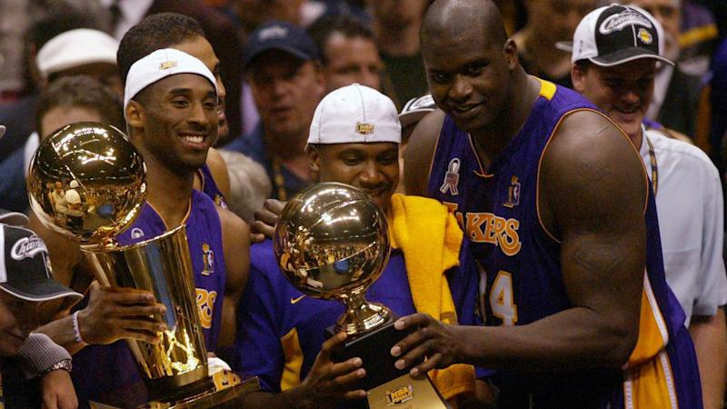 Lakers teammates Kobe Bryant, Lindsey Hunter and Shaquille O'Neal celebrate.