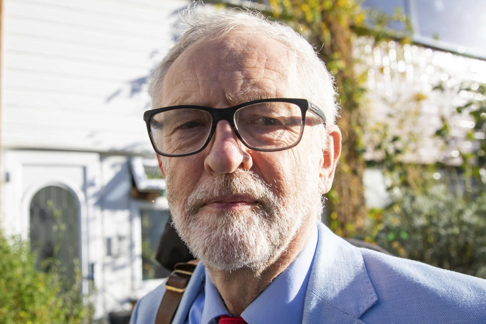 Britain's former opposition Labour Party leader Jeremy Corbyn leaves his home in London, Wednesday Nov. 18, 2020. Corbyn will be reinstated into the political party it is announced Wednesday after a three-week suspension as Labour's National Executive Committee seeks to draw a line under years of tumultuous divisions over alleged anti-Jewish prejudice in the party. (Aaron Chown/PA via AP)