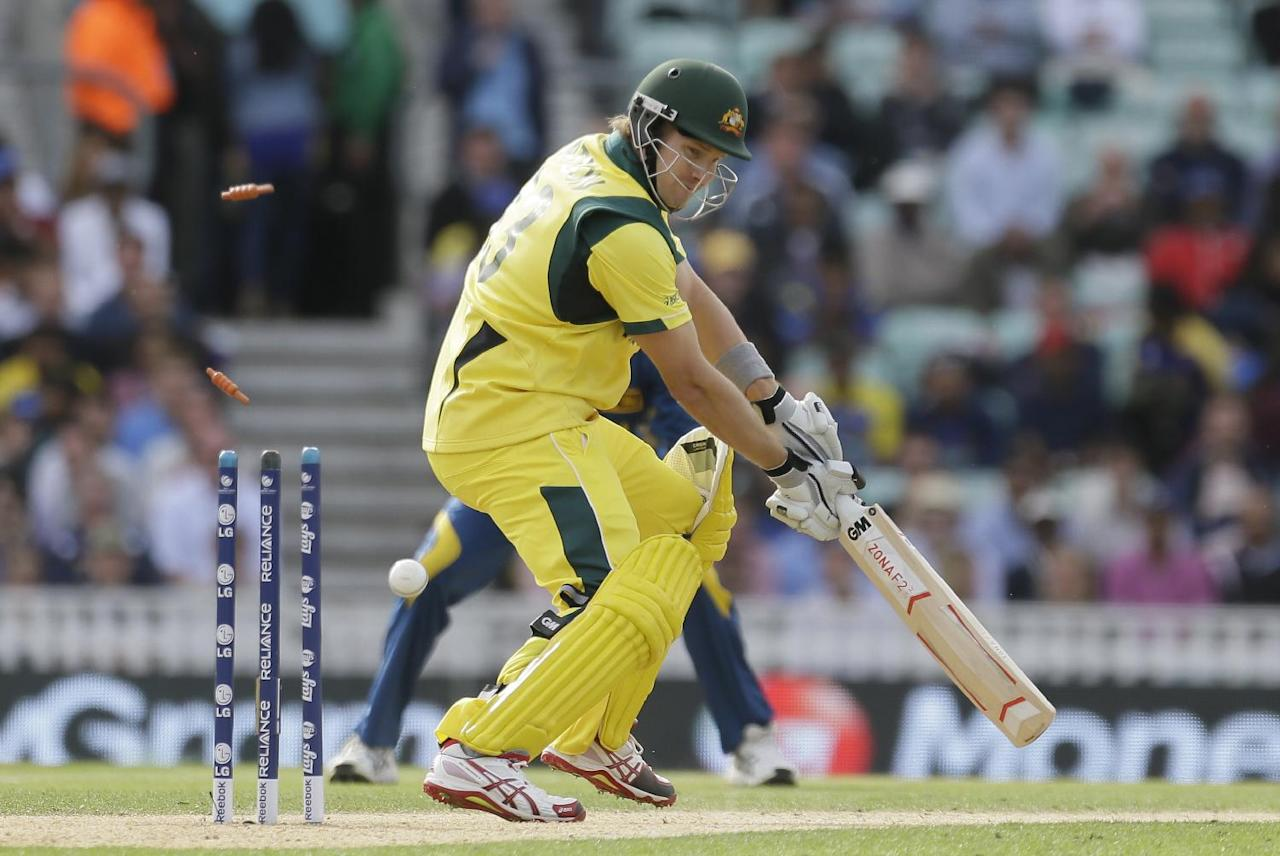 Australia's Shane Watson is clean bowled by Sri Lanka's Nuwan Kulasekera, unseen, during their ICC Champions Trophy cricket match at the Oval cricket ground in London, Monday, June 17, 2013. (AP Photo/Alastair Grant)