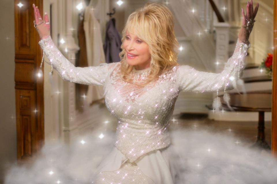 "Dolly Parton as Angel in ""Dolly Parton's Christmas on the Square."""
