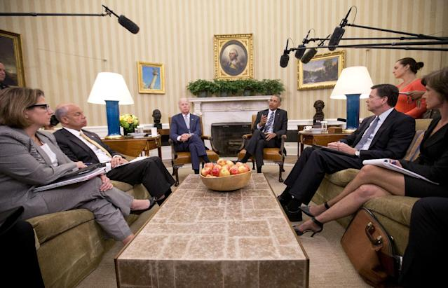 <p>President Barack Obama, center, speaks to members of the media in the Oval Office of the White House in Washington, Monday, June 13, 2016, after getting briefed on the investigation in to the shooting at a nightclub in Orlando. (AP Photo/Pablo Martinez Monsivais) </p>