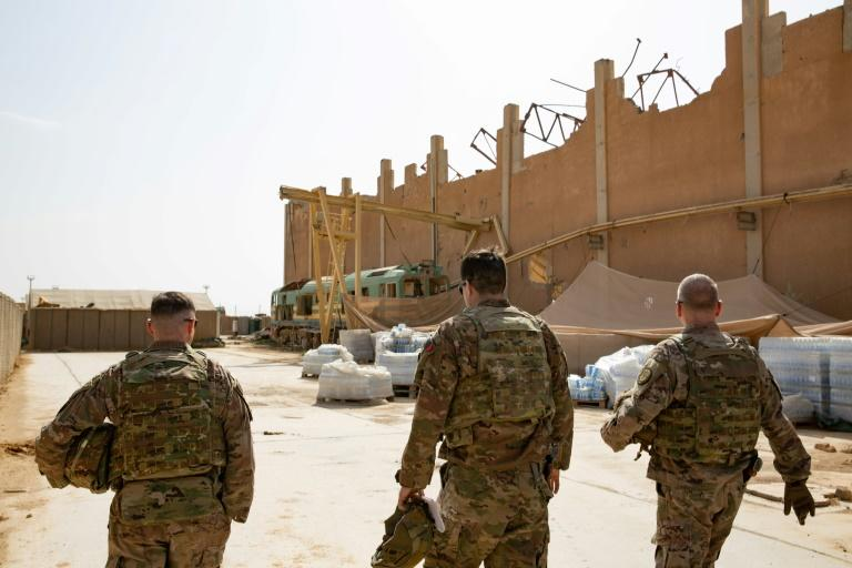 US Brigadier General Vincent Barker (R) toured the US base in Qaim, Iraq as troops prepare for redeployment -- US-led coalition sources said hundreds of troops would be moved, some out of the country
