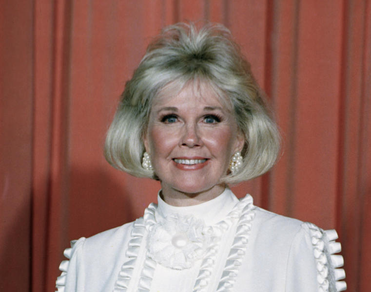 FILE - In this Jan. 28, 1989 file photo, actress and animal rights activist Doris Day poses for photos after receiving the Cecil B. DeMille Award she was presented with at the annual Golden Globe Awards ceremony in Los Angeles, Calif. Doris Day, a top box-office draw and recording artist who died in May 2019, stood for the 1950s ideal of innocence and G-rated love, a parallel world to her contemporary Marilyn Monroe. She received a Presidential Medal of Freedom in 2004. (AP Photo, File)