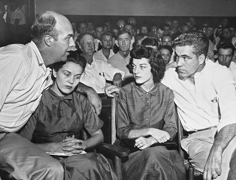 (From left) J.W. Milam; his wife, Juanita Milam; Carolyn Bryant; and Roy Bryant during the men's murder trial in 1955. They were acquitted by an all-white jury. (Bettmann / Getty Images)