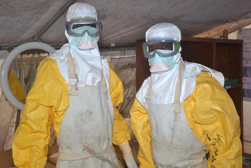 Health workers pose at the Ebola Donka treatment centre in Conakry on December 8, 2014