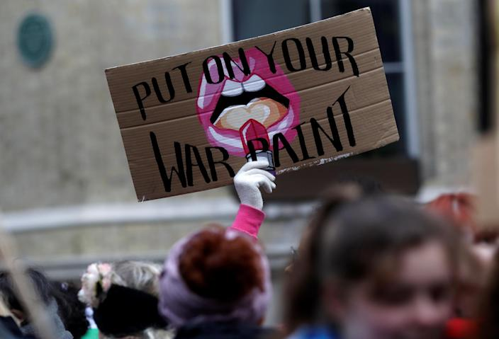 A protester holds up a sign during the Women's March calling for equality, justice and an end to austerity in London, Britain, Jan.19, 2019. (Photo: Simon Dawson/Reuters)