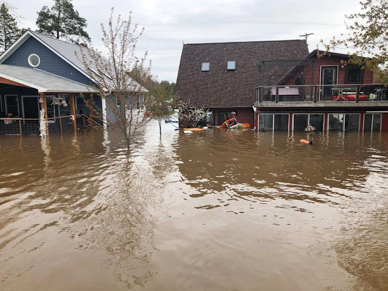 The Schulz and Lackey cottages during the flooding. (Courtesy of Sarah Schulz)