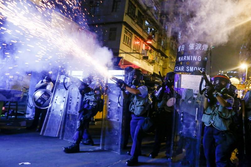 FILE PHOTO: Police fire tear gas at anti-extradition bill protesters during clashes in Sham Shui Po in Hong Kong