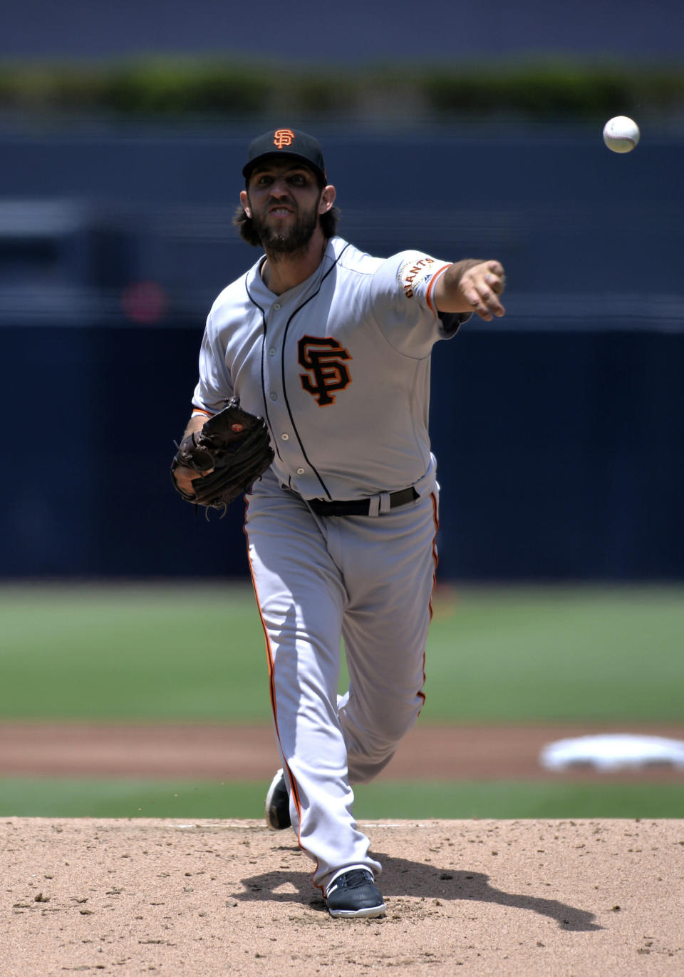 San Francisco Giants starting pitcher Madison Bumgarner works against a San Diego Padres batter during the first inning of a baseball game Sunday, July 28, 2019, in San Diego. (AP Photo/Orlando Ramirez)