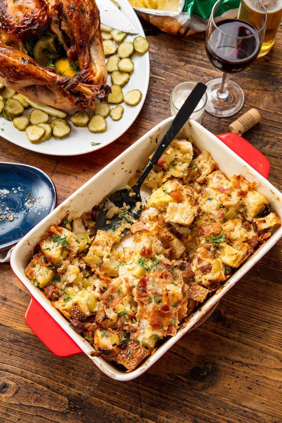 """<p>Beer nicely cuts the richness of the bacon and cheddar in this stuffing recipe.</p><p>Get the recipe from <a href=""""https://www.delish.com/cooking/recipe-ideas/recipes/a44603/cheddar-bacon-beer-stuffing-recipe/"""" rel=""""nofollow noopener"""" target=""""_blank"""" data-ylk=""""slk:Delish"""" class=""""link rapid-noclick-resp"""">Delish</a>.</p>"""