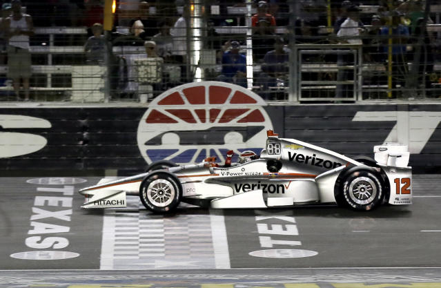 FILE - In this June 10, 2017, file photo, Will Power, of Australia, pumps his fist as he crosses the finish line under yellow to win an IndyCar auto race at Texas Motor Speedway, in Fort Worth, Texas. IndyCar is getting ready for an all-in-one-day season opener on the fast track in Texas, more than 2 months after drivers were set to roll on the streets of St. Pete. The pandemic-delayed season is now set to open Saturday, June 6, 2020. (AP Photo/Tony Gutierrez, File)