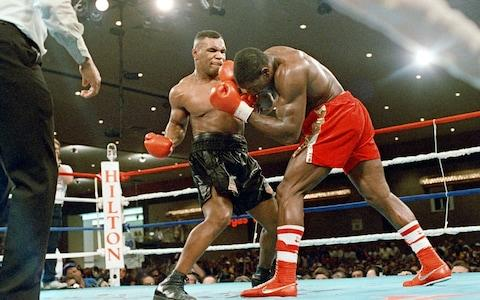 <span>Bruno, right, was beaten by Tyson in 1989 and lost to him again in 1996</span> <span>Credit: MIRRORPIX </span>