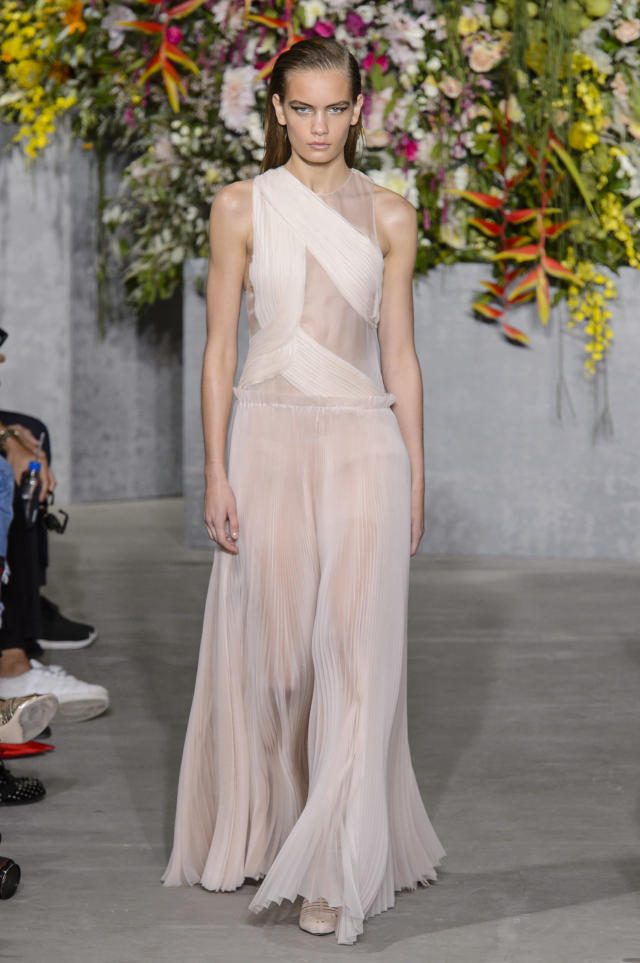 <p><i>A model wears a semi-sheer Grecian-style dress from the SS18 Jason Wu collection. (Photo: ImaxTree) </i></p>