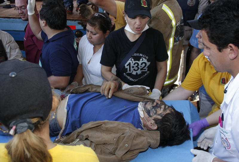 A farmer wounded in a land dispute is carried on a gurney to a nearby hospital, in Curuguaty, Paraguay, Friday, June 15, 2012. Paraguay deployed its army on Friday to resolve the violent land dispute in Curuguaty, a remote northern forest reserve, where 17 people have been killed in gun battles between police and landless farmers when police were trying to evict about 150 farmers from the reserve, which is part of a huge estate owned by a Colorado Party politician opposed to leftist President Fernando Lugo. (AP Photo)