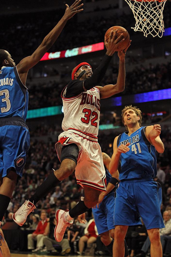 CHICAGO, IL - APRIL 21: Richard Hamilton #32 of the Chicago Bulls drives to the basket between Rodrigue Baeubois #3 and Dirk Nowitzki #41 of the Dallas Mavericks at the United Center on April 21, 2012 in Chicago, Illinois. The Bulls defeated the Mavericks 93-83. NOTE TO USER: User expressly acknowledges and agress that, by downloading and/or using this photograph, User is consenting to the terms and conditions of the Getty Images License Agreement. (Photo by Jonathan Daniel/Getty Images)