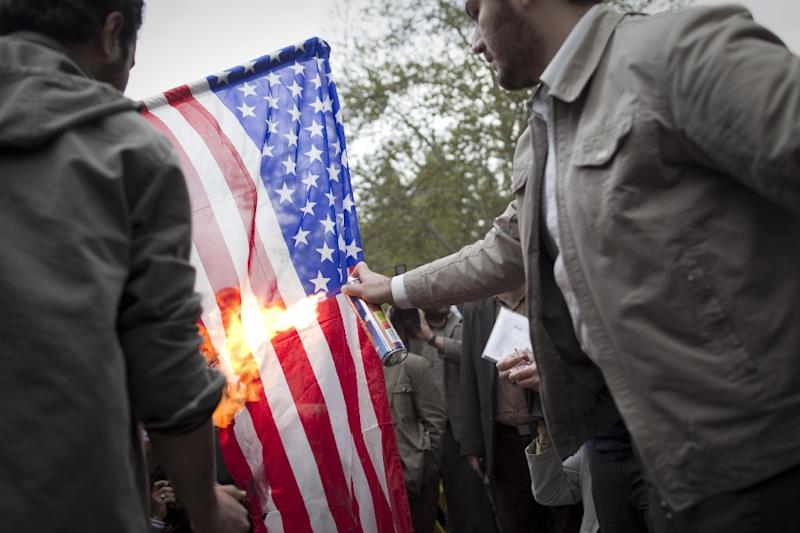 Iranian students burn a US flag during a 2011 protest in Tehran (AFP Photo/Behrouz Mehri)
