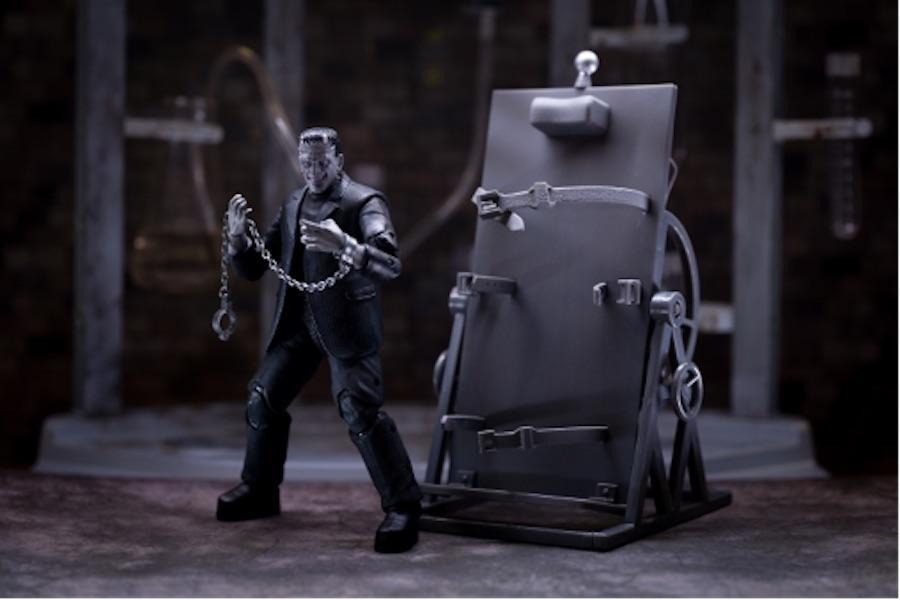 Jada Toy's deluxe greyscale Frankenstein's Monster figure with operating table and accessories