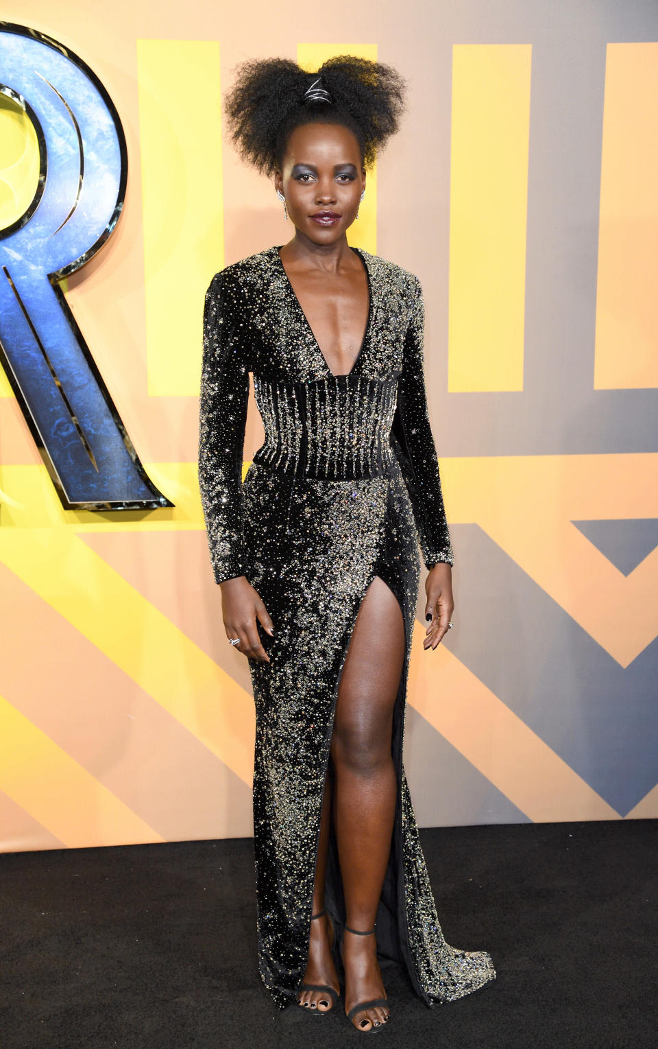 A heavily-embellished Balmain number also proved a hit with fashion critics [Photo: Getty]