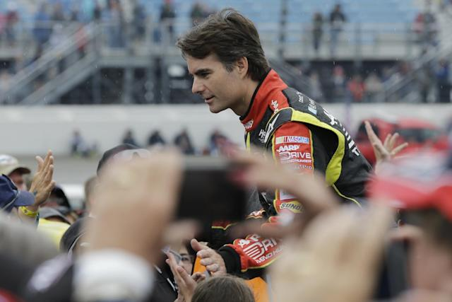 Jeff Gordon greets with fans during drivers' introduction before the NASCAR Sprint Cup series auto race at Chicagoland Speedway in Joliet, Ill., Sunday, Sept. 15, 2013. (AP Photo/Nam Y. Huh)