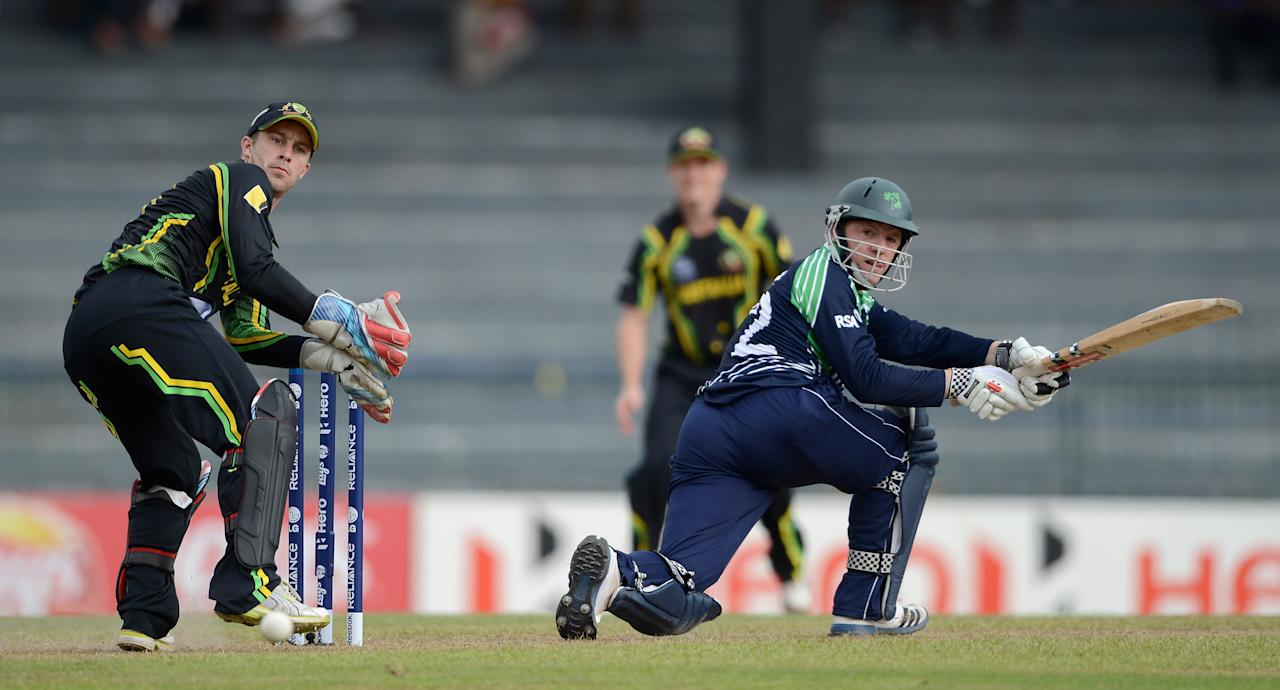 COLOMBO, SRI LANKA - SEPTEMBER 19:  Niall O'Brien of Ireland hits past Australia wicketkeeper Matthew Wade during ICC World Twenty20 2012: Group B match between Australia and Ireland at R. Premadasa Stadium on September 19, 2012 in Colombo, Sri Lanka.  (Photo by Gareth Copley/Getty Images)