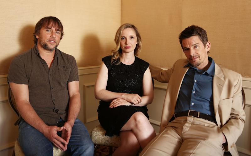 """In this Monday, May 20, 2013 photo, from left, director and writer, Richard Linklater, actress and writer, Julie Delpy and actor and writer, Ethan Hawke from the film """"Before Midnight,"""" pose for a portrait in Los Angeles. This is the third film in the drama series of walking, talking European romances. The movie releases in the US on Friday, May 24, 2013. (Photo by Matt Sayles/Invision/AP)"""