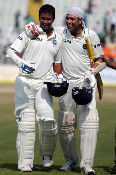 MOHALI, INDIA - OCTOBER 05:  Pragyan Ojha (L) and VVS Laxman of India celebrate India winning their first test on day five of the First Test match between India and Australia at Punjab Cricket Association Stadium on October 5, 2010 in Mohali, India.  (Photo by Pal Pillai/Getty Images)