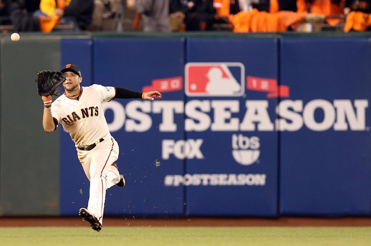 SAN FRANCISCO, CA - OCTOBER 22:  Gregor Blanco #7 of the San Francisco Giants catches a fly ball in the fourth inning against the St. Louis Cardinals in Game Seven of the National League Championship Series at AT&T Park on October 22, 2012 in San Francisco, California.  (Photo by Christian Petersen/Getty Images)