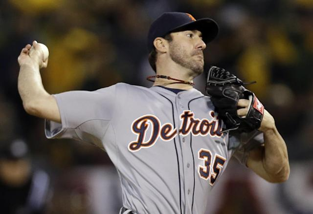 Detroit Tigers pitcher Justin Verlander delivers a pitch in the seventh inning of Game 5 of an American League baseball division series against the Oakland Athletics in Oakland, Calif., Thursday, Oct. 10, 2013. (AP Photo/Marcio Jose Sanchez)