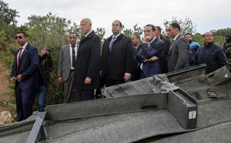 Tunisian President Kais Saied (C-L) and Prime Minister Youssef Chahed (C) visited the site of the road accident, one of Tunisia's worst (AFP Photo/Fethi Belaid)